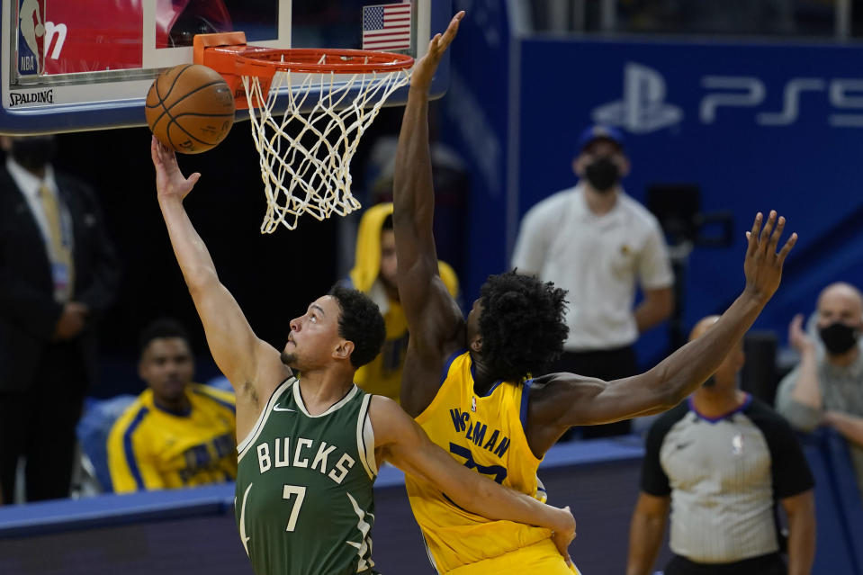 Milwaukee Bucks guard Bryn Forbes (7) shoots Golden State Warriors center James Wiseman during the first half of an NBA basketball game in San Francisco, Tuesday, April 6, 2021. (AP Photo/Jeff Chiu)