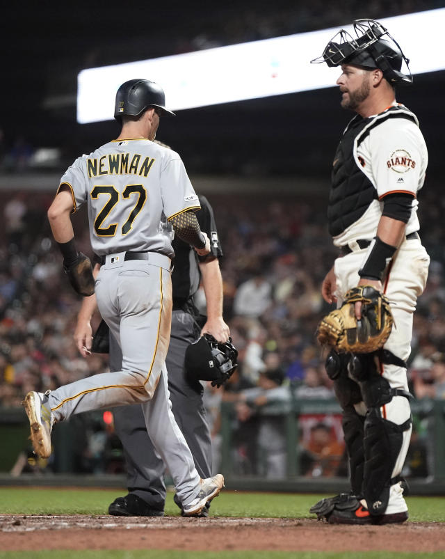 Pittsburgh Pirates' Kevin Newman (27) scores a run past San Francisco Giants catcher Stephen Vogt, right, on a single by Colin Moran during the fifth inning of a baseball game Wednesday, Sept. 11, 2019, in San Francisco. (AP Photo/Tony Avelar)