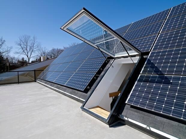 Homeowners in Edmonton have installed renewable energy platforms like this home in Belgravia with roof of solar panels. (Effect Home Builders - image credit)