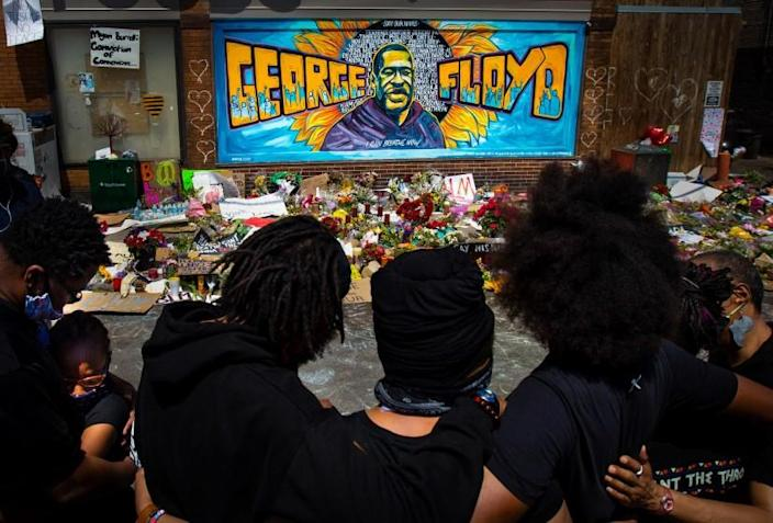 MINNEAPOLIS , MINNESOTA - JUNE 01: The Holloway family pay their respects at the makeshift memorial at Cup Foods where George Floyd was killed by a Minneapolis police officer on Monday, June 1, 2020 in Minneapolis, Minnesota.