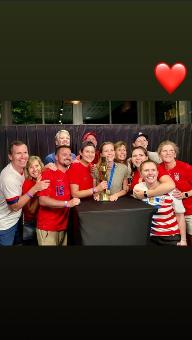 Defender Tierna Davidson gathers with family and friends around the World Cup trophy to celebrate the USWNT's victory. (@tierna_davidson/Instagram)