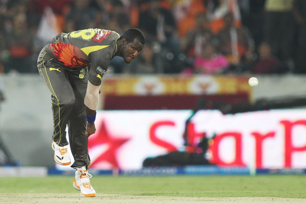 Darren Sammy of Sunrisers Hyderabad sends down a delivery during match 68 of the Pepsi Indian Premier League between The Sunrisers Hyderabad and The Rajasthan Royals held at the Rajiv Gandhi International Stadium, Hyderabad  on the 17th May 2013..Photo by Shaun Roy-IPL-SPORTZPICS ..Use of this image is subject to the terms and conditions as outlined by the BCCI. These terms can be found by following this link:..https://ec.yimg.com/ec?url=http%3a%2f%2fwww.sportzpics.co.za%2fimage%2fI0000SoRagM2cIEc&t=1506314104&sig=nlDdeWPss9hqBQyh5vBRaQ--~D