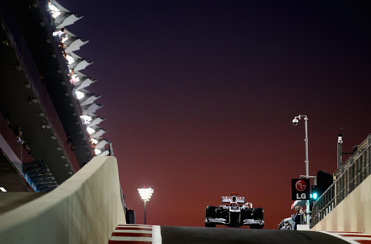 xABU DHABI, UNITED ARAB EMIRATES - NOVEMBER 11:  Rubens Barrichello of Brazil and Williams drives down the pitlane during practice for the Abu Dhabi Formula One Grand Prix at the Yas Marina Circuit on November 11, 2011 in Abu Dhabi, United Arab Emirates.  (Photo by Clive Mason/Getty Images)