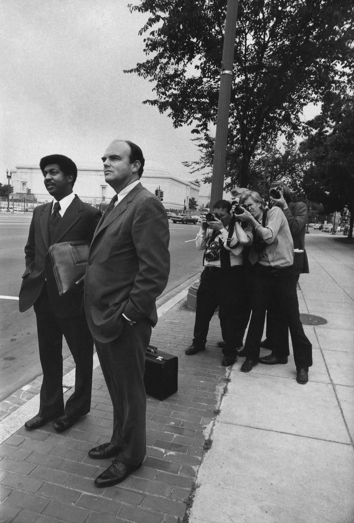 WASHINGTON - NOVEMBER: (NO U.S. TABLOID SALES) Former Senior Advisor to President Richard Nixon, John Ehrilchman waits for a cab in front of the Federal courthouse after testifying in the Watergate scandal on November 1973 in Washington DC. Ehrilchman was indited for Watergate Crimes. (Photo by David Hume Kennerly/Getty images)