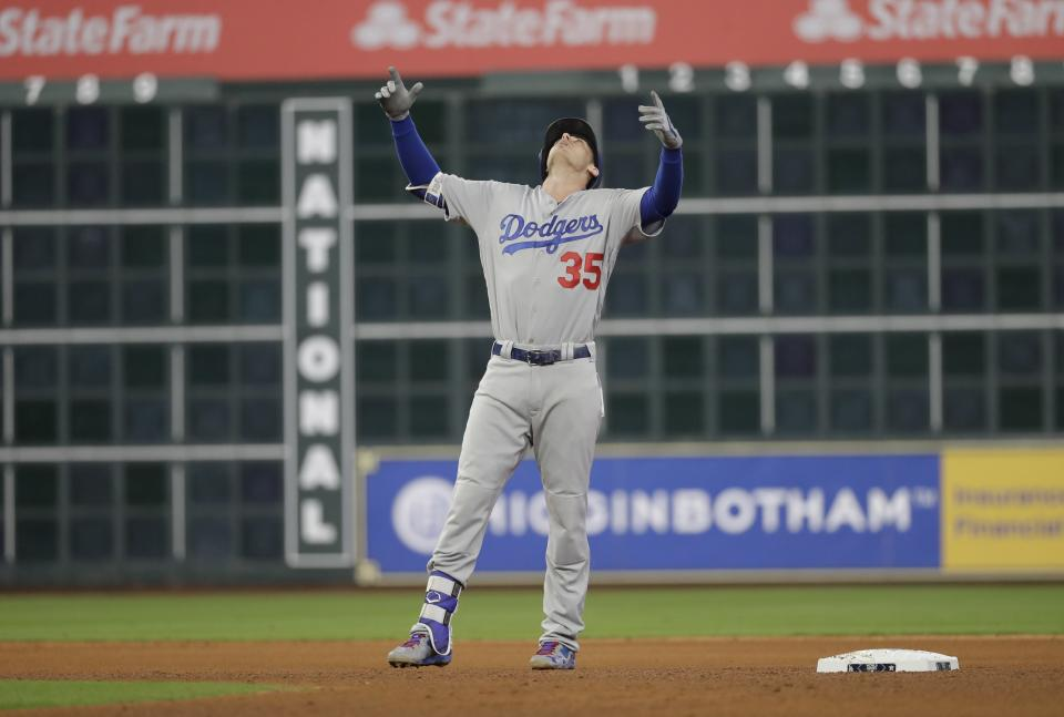Cody Bellinger reacts after hitting a double during the seventh inning of Game 4 of the World Series. (AP)