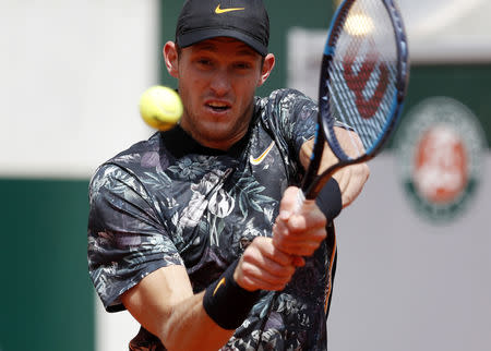 Tennis - French Open - Roland Garros, Paris, France - May 28, 2019. Chile's Nicolas Jarry in action during his first round match against Argentina's Juan Martin del Potro. REUTERS/Vincent Kessler