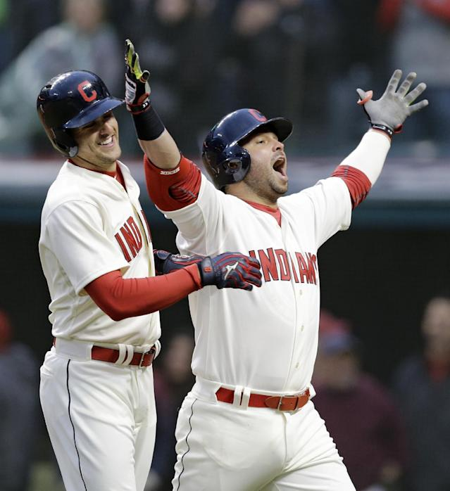 Cleveland Indians' Nick Swisher, right, looks to the fans as he celebrates with Lonnie Chisenhall after Swisher hit a two-run home run off Minnesota Twins starting pitcher Mike Pelfrey in the sixth inning of a baseball game, Friday, April 4, 2014, in Cleveland. Chisenhall scored. (AP Photo/Mark Duncan)
