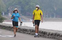 CHANDIGARH, INDIA - JUNE 7: A couple out on a morning walk at Sukhna Lake, on June 7, 2020 in Chandigarh, India. (Photo by Keshav Singh/Hindustan Times via Getty Images)