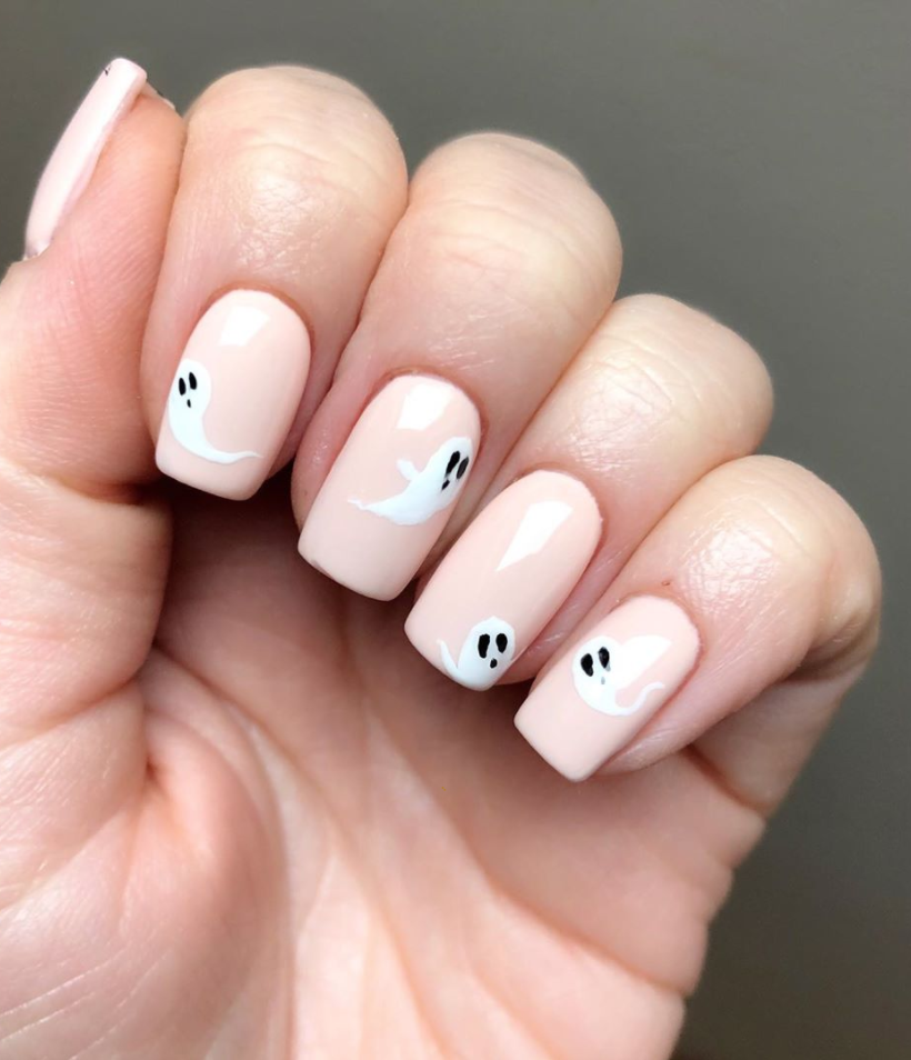 """<p>Not all ghosts are scary! To bring some friendly ghosts into your life try out this look created by the Daily Nail Spa for <a href=""""https://www.instagram.com/p/B4CYLEUgHuK/"""" rel=""""nofollow noopener"""" target=""""_blank"""" data-ylk=""""slk:Jessica Cosmetics"""" class=""""link rapid-noclick-resp"""">Jessica Cosmetics</a> by adding some chic floaters on a pale pastel pink base. </p><p><a class=""""link rapid-noclick-resp"""" href=""""https://go.redirectingat.com?id=74968X1596630&url=https%3A%2F%2Fwww.etsy.com%2Flisting%2F832886787%2Fhalloween-ghost-nail-art-decal-sticker&sref=https%3A%2F%2Fwww.oprahdaily.com%2Fbeauty%2Fskin-makeup%2Fg33239588%2Fhalloween-nail-ideas%2F"""" rel=""""nofollow noopener"""" target=""""_blank"""" data-ylk=""""slk:SHOP GHOST NAIL STICKERS"""">SHOP GHOST NAIL STICKERS</a></p>"""