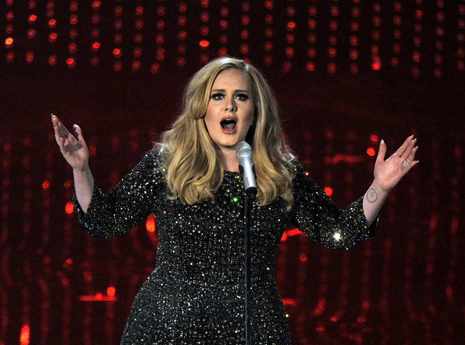 """FILE - In this Feb. 24, 2013 file photo, singer Adele performs during the Oscars at the Dolby Theatre in Los Angeles. Adele is asking presidential candidates to stop using her music at their campaign events. """"Adele has not given permission for her music to be used for any political campaigning,"""" a spokesman for the singer said in a statement Tuesday, Feb. 2, 2016. Trump has played the British singer's """"Rolling in the Deep"""" in Oklahoma and the """"Skyfall"""" theme at an event in Ohio. Former Gov. Mike Huckabee also posted a parody video of Adele's """"Hello,"""" which was muted after Adele's team intervened. (Photo by Chris Pizzello/Invision/AP, File)"""