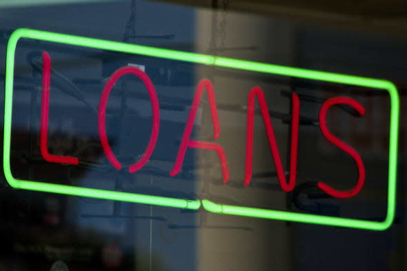 during economic crisis, this red and green neon LOANS sign in a retail window was one of many seen all over Houston