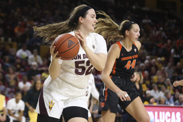 Arizona State's Jamie Ruden (52) looks to pass after winning a rebound against Oregon State's Taylor Jones (44) during the first half of an NCAA college basketball game Sunday, Jan. 12, 2020, in Tempe, Ariz. (AP Photo/Darryl Webb)