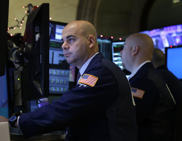 Traders work on the floor at the New York Stock Exchange in New York, Tuesday, Dec. 31, 2013. (AP Photo/Seth Wenig)