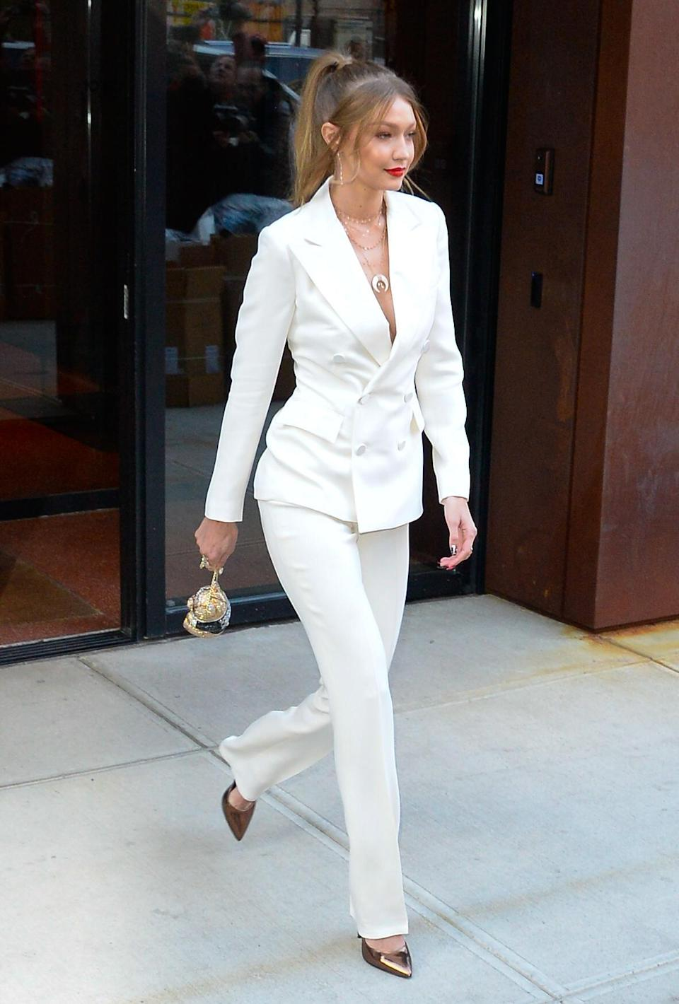 <p>Model Gigi Hadid was spotted strolling around town in a fierce white suit on October 23 with a glitzy teddy Judith Leiber bag to finish. <em>[Photo: Getty]</em> </p>