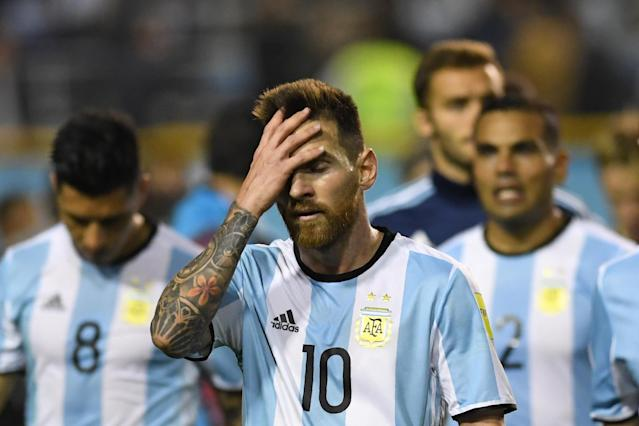 Head in hands: Lionel Messi now needs a football fairytale to ever get his hands on the World Cup
