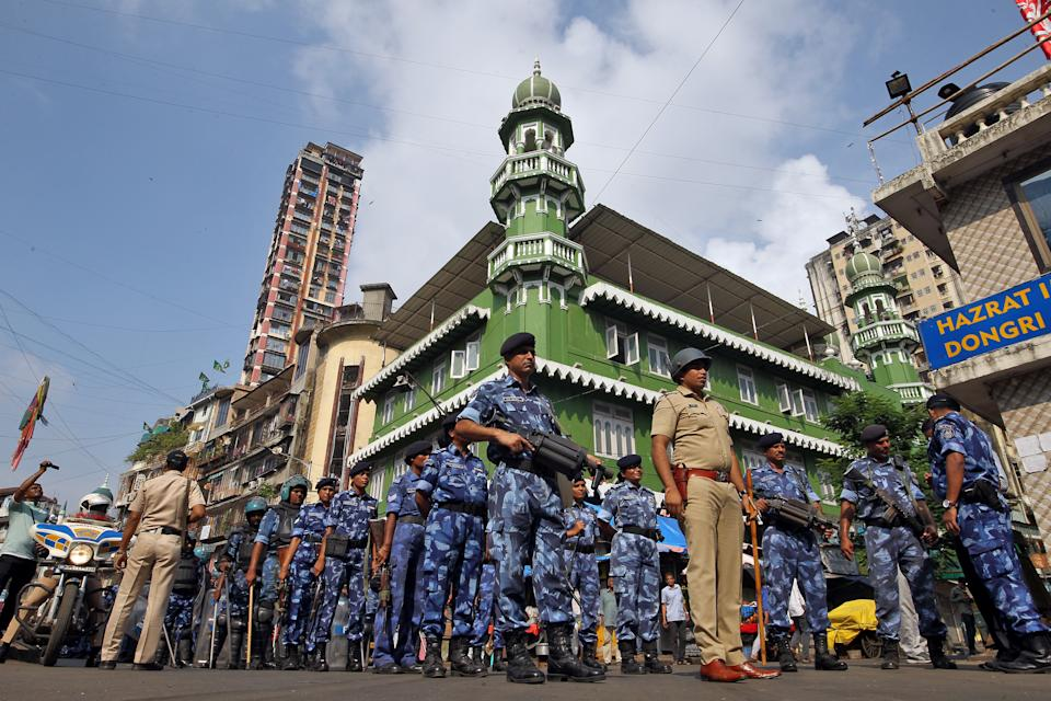 Rapid Action Force (RAF) personnel stand guard outside a mosque before Supreme Court's verdict on a disputed religious site in Ayodhya, in Mumbai, India November 9, 2019. REUTERS/Prashant Waydande