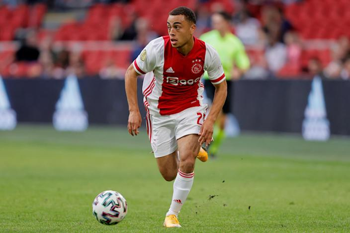 USMNT fullback Sergiño Dest is reportedly heading to Barcelona from Ajax. (Photo by Erwin Spek/Soccrates/Getty Images)