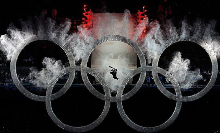 """<p><a href=""""http://www.coastreporter.net/sports/local-sports/olympic-snowboarder-to-share-story-of-the-rings-1.2099175"""" rel=""""nofollow noopener"""" target=""""_blank"""" data-ylk=""""slk:Snowboarder Johnny Lyall"""" class=""""link rapid-noclick-resp"""">Snowboarder Johnny Lyall</a> flew through the Olympic rings in a grand spectacle.</p>"""