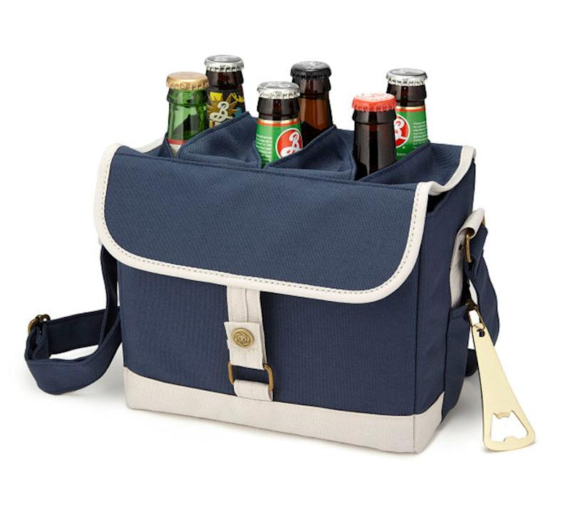 """The most efficient and most stylish way to transport beer. Plus: it comes with a bottle opener, because as the description says, opening a beer with a rock isn't cool. Get it <a href=""""https://www.uncommongoods.com/product/beer-caddy-with-bottle-opener"""" target=""""_blank"""" rel=""""noopener noreferrer"""">at Uncommon Goods</a> for $39.89."""