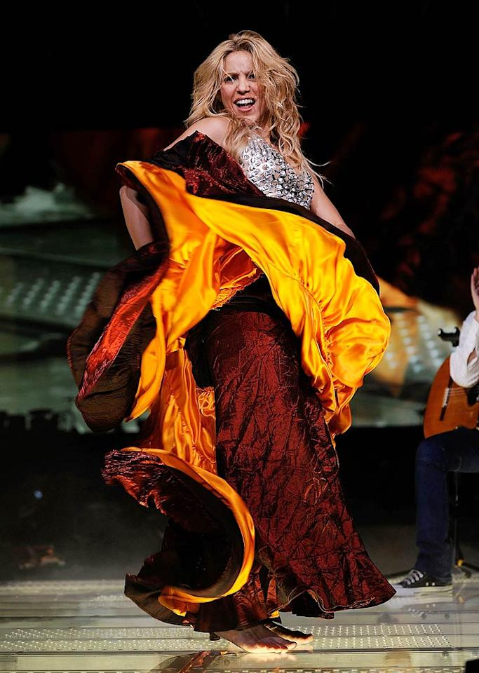 "The ""Hips Don't Lie"" singer twirled the skirt of one of her many costumes during her barefoot performance of hits including ""Whenever, Wherever"" and ""Waka Waka,"" the tune she sang at the World Cup. Larry Busacca/<a href=""http://www.gettyimages.com/"" target=""new"">GettyImages.com</a> - September 21, 2010"