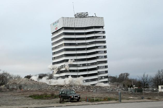CHRISTCHURCH, NEW ZEALAND - AUGUST 05:  A building is demolished by controlled explosions on August 5, 2012 in Christchurch, New Zealand. The 14-story Radio Network House building in Worcester St, is the first of its kind in the city to be blown up in a controlled demolition since authorities began the massive task of bringing down the hundreds of quake-damaged buildings. The building was badly damaged in the magnitude-6.3 February 22, 2011 earthquake.  (Photo by Martin Hunter/Getty Images)
