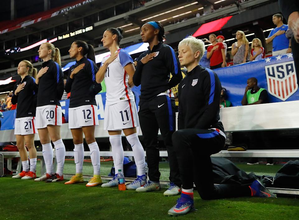ATLANTA, GA - SEPTEMBER 18:  Megan Rapinoe #15 kneels during the National Anthem prior to the match between the United States and the Netherlands at Georgia Dome on September 18, 2016 in Atlanta, Georgia.  (Photo by Kevin C. Cox/Getty Images)