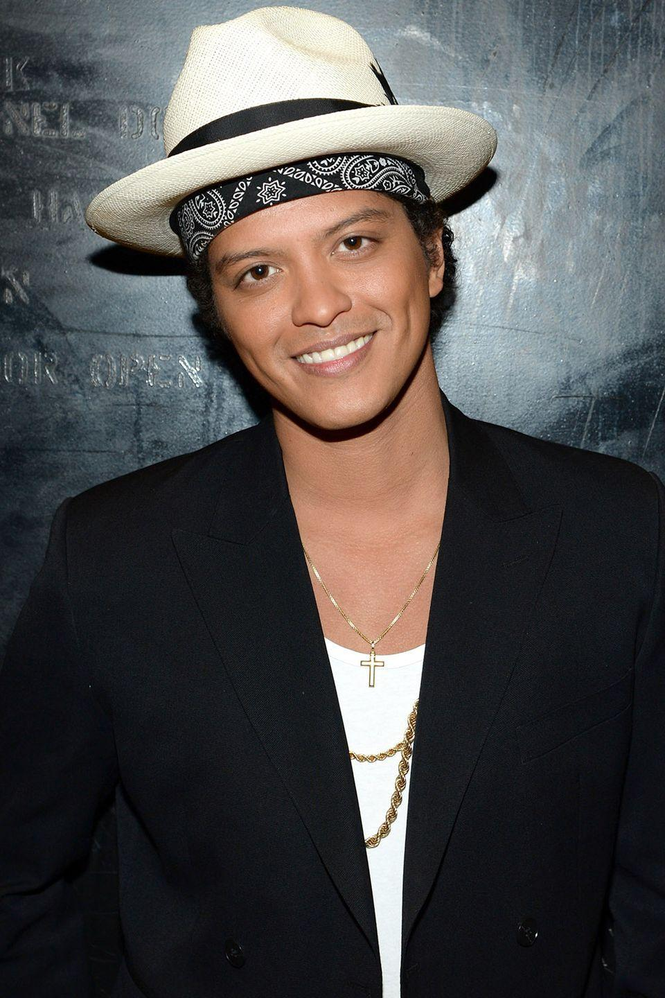 """<p><strong>Born</strong>: Peter Gene Hernandez</p><p>In a 2013 interview with <em><a href=""""https://www.gq.com/story/bruno-mars-interview-gq-april-2013#ixzz2OD5xERaE"""" rel=""""nofollow noopener"""" target=""""_blank"""" data-ylk=""""slk:GQ"""" class=""""link rapid-noclick-resp"""">GQ</a></em>, the """"Finesse"""" singer explained that he's been Bruno for almost his entire life. Though he was born Peter Hernandez, he received the nickname Bruno because as a toddler, he looked like the famous wrestler Bruno Sammartino. But Bruno Hernandez wasn't cutting it in the music world. """"Your last name's Hernandez, maybe you should do this Latin music, this Spanish music... Enrique's so hot right now,"""" the singer told the publication of the responses he received while trying to start his music career. Thus, he adopted the Mars surname.</p>"""