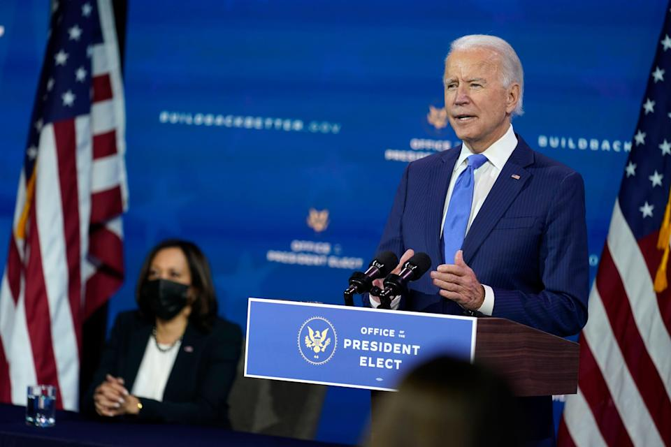 President-elect Joe Biden speaks as Vice President-elect Kamala Harris listens at left, during an event to introduce their nominees and appointees to economic policy posts at The Queen theater, Tuesday, Dec. 1, 2020, in Wilmington, Delaware.