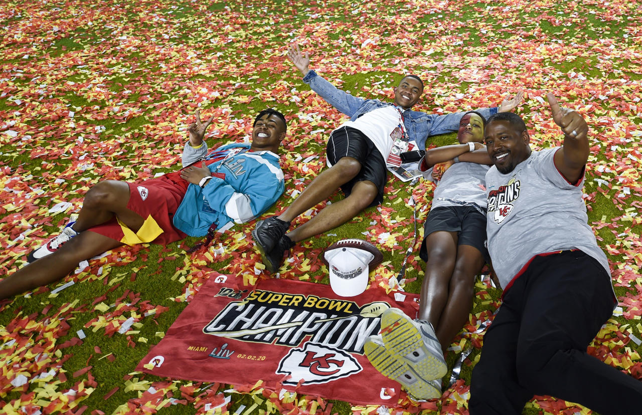 Along with his sons, Kansas City Chiefs defensive back coach Dave Merritt, right, celebrates after a 31-20 victory in Super Bowl LIV against the San Francisco 49ers on Sunday, Feb. 2, 2020, at Hard Rock Stadium in Miami Gardens, Fla. (Tammy Ljungblad/Kansas City Star/Tribune News Service via Getty Images)