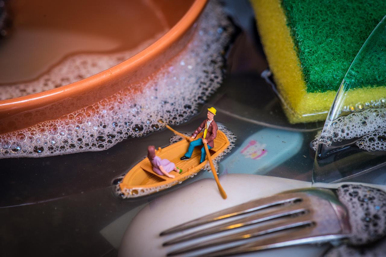 <p>Péter said he gets the figures from train model companies, but spends weeks carefully constructing each diorama and setting up the lighting before taking the photographs.<br />In this shot, a miniature couple sail around a sink full of dirty dishes. (SWNS) </p>