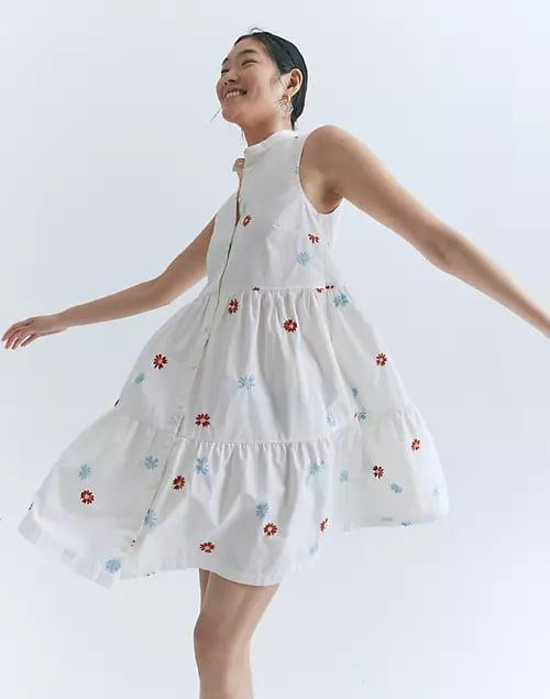 <p>The print on this <span>Madewell Daisy Embroidered Banded-Collar Tiered Dress</span> ($98) is so happy and adorable. </p>