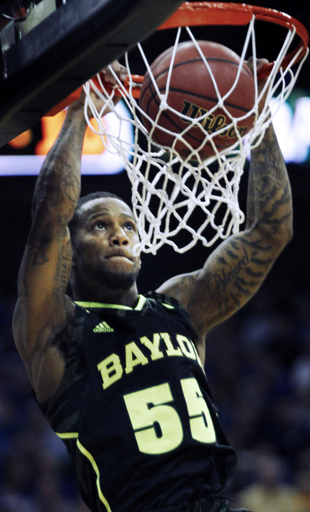 Baylor guard Pierre Jackson (55) dunks during the first half of an NCAA college basketball game against Kansas in the Big 12 tournament on Friday, March 9, 2012, in Kansas City, Mo. (AP Photo/Orlin Wagner)