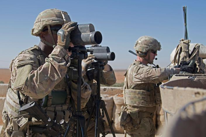 In this Nov. 1, 2018, photo released by the U.S. Army, soldiers surveil the area during a combined joint patrol in Manbij, Syria. (Photo: ASSOCIATED PRESS)