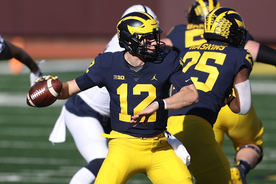 ANN ARBOR, MICHIGAN - NOVEMBER 28: Cade McNamara #12 of the Michigan Wolverines throws a first half pass against the Penn State Nittany Lions at Michigan Stadium on November 28, 2020 in Ann Arbor, Michigan. (Photo by Gregory Shamus/Getty Images)
