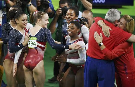 2016 Rio Olympics - Artistic Gymnastics - Final - Women's Team Final - Rio Olympic Arena - Rio de Janeiro, Brazil - 09/08/2016. (From L) Alexandra Raisman (USA) of USA (Aly Raisman), Laurie Hernandez (USA) of USA, Madison Kocian (USA) of USA, Gabrielle Douglas (USA) of USA (Gabby Douglas) and Simone Biles (USA) of USA celebrate winning the gold in the women's team final. REUTERS/Dylan Martinez