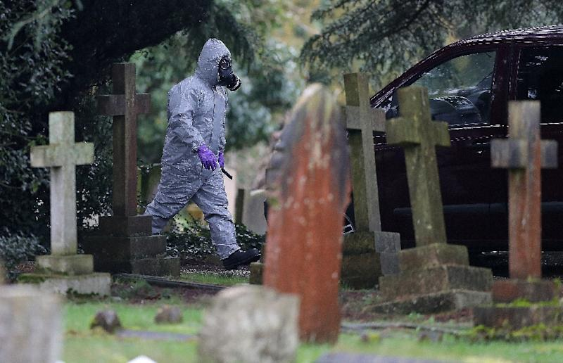 Emergency personnel in biohazard suits have been deployed in normally quiet Salisbury, as police and soldiers scour affected areas in the city (AFP Photo/Daniel LEAL-OLIVAS)