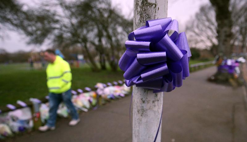 Purple bows and ribbons attached to lamp posts and railings in St Neot's Road, Harold Hill, east London, after the stabbing. (PA)