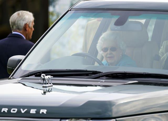 The Queen in an electric hybrid Range Rover