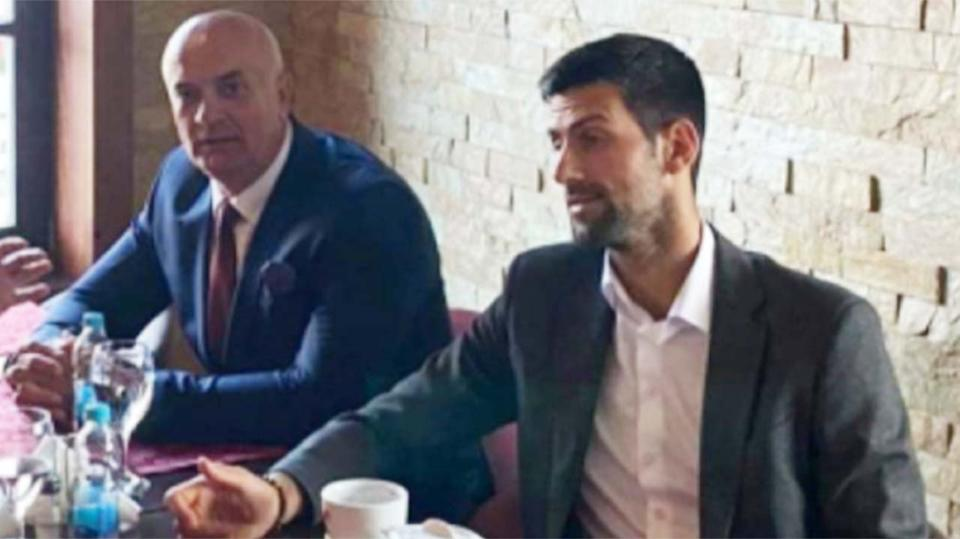 Novak Djokovic (pictured right) was photographed with tea with a controversial figure during his free from tennis.