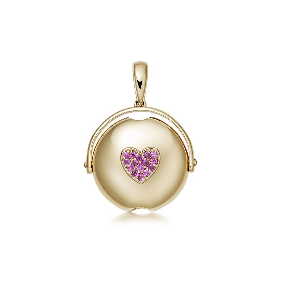"""<p><a class=""""link rapid-noclick-resp"""" href=""""https://www.loquetlondon.com/shop/lumiere/lumiere-luna-sapphire-heart.html"""" rel=""""nofollow noopener"""" target=""""_blank"""" data-ylk=""""slk:SHOP NOW"""">SHOP NOW</a></p><p>This necklace charm contains a microscopic lens through which viewers can spy a hidden """"I Love You"""" message (or your own personalised memo). </p><p>Gold and pink sapphire charm, £950, <a href=""""https://www.loquetlondon.com"""" rel=""""nofollow noopener"""" target=""""_blank"""" data-ylk=""""slk:Loquet London"""" class=""""link rapid-noclick-resp"""">Loquet London</a>.</p>"""