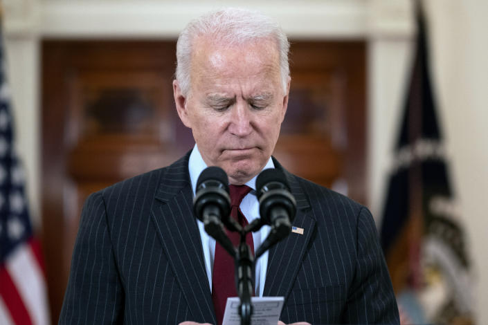 President Joe Biden reads the number of American that died from COVID-19 during a speech at the White House, Monday, Feb. 22, 2021, in Washington. (AP Photo/Evan Vucci)