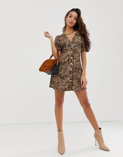 """<p>This <a href=""""https://www.popsugar.com/buy/ASOS-DESIGN-Animal-Print-Dress-481619?p_name=ASOS%20DESIGN%20Animal%20Print%20Dress&retailer=us.asos.com&pid=481619&price=27&evar1=fab%3Aus&evar9=45278025&evar98=https%3A%2F%2Fwww.popsugar.com%2Ffashion%2Fphoto-gallery%2F45278025%2Fimage%2F46553667%2FASOS-DESIGN-Animal-Print-Dress&list1=shopping%2Cfall%20fashion%2Cdresses%2Cfall%2Caffordable%20shopping&prop13=mobile&pdata=1"""" rel=""""nofollow"""" data-shoppable-link=""""1"""" target=""""_blank"""" class=""""ga-track"""" data-ga-category=""""Related"""" data-ga-label=""""https://us.asos.com/asos-design/asos-design-button-through-rib-tea-dress-with-puff-sleeve-in-animal-print/prd/11388095?clr=animal-print&amp;colourWayId=16349868&amp;SearchQuery=animal%20print%20dresses"""" data-ga-action=""""In-Line Links"""">ASOS DESIGN Animal Print Dress</a> ($27, originally $45) is such a great deal.</p>"""