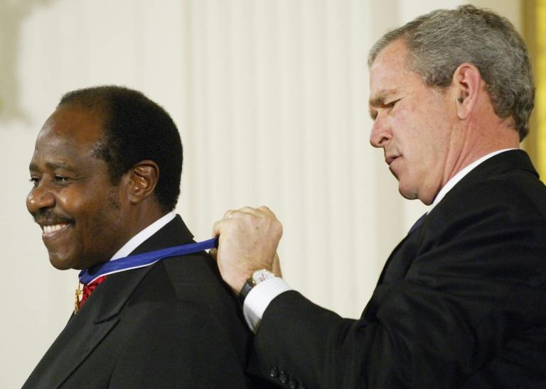 Then US president George W. Bush awarded Rusesabagina the Presidential Medal of Freedom in 2005 (AFP/MANDEL NGAN)