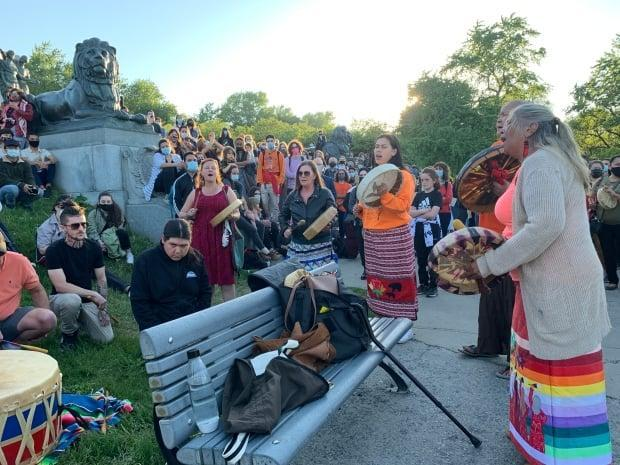 A vigil was held for the victims, some as young as three years old, on Monday near the George-Étienne Cartier Monument in Mount Royal Park. (Sharon Yonan-Renold/CBC - image credit)
