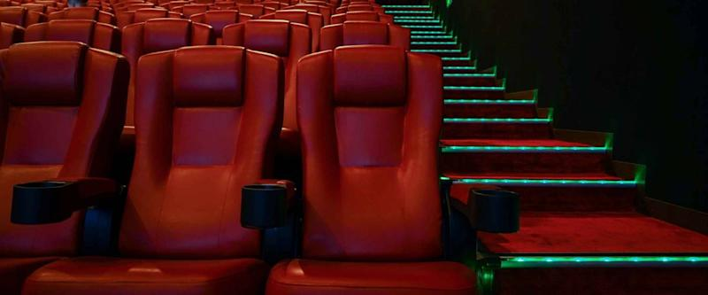 Movie theater with red seats in luxury hotel.