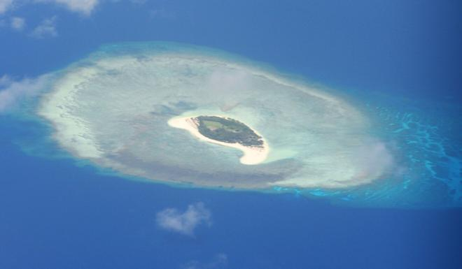 An aerial photo of a reef in the Spratly Islands in the South China Sea. The United States has announced sanctions and restrictions on 24 Chinese companies and associated officials for taking part in building artificial islands in the disputed waters. Photo: AFP