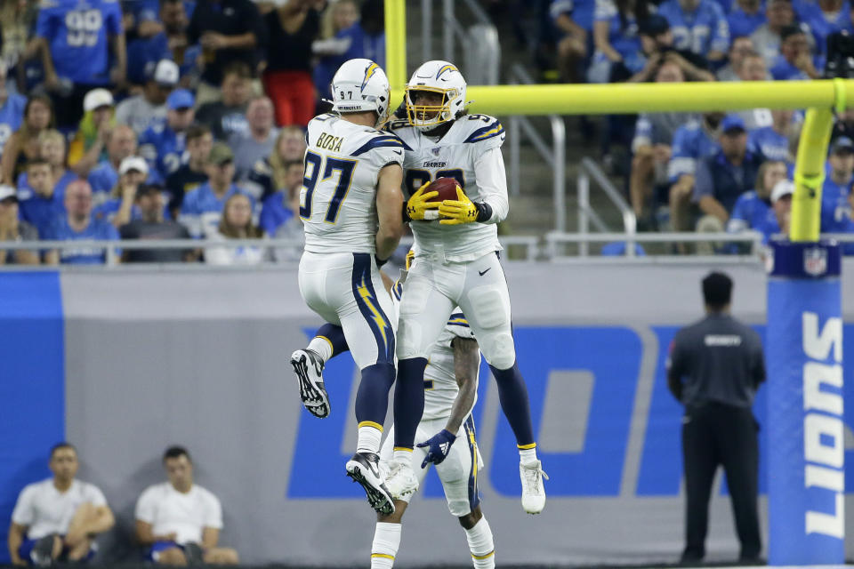 Los Angeles Chargers defensive end Joey Bosa (97) and Isaac Rochell (98) celebrate in the first half of an NFL football game against the Detroit Lions in Detroit, Sunday, Sept. 15, 2019. (AP Photo/Duane Burleson)
