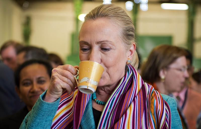 U.S. Secretary of State Hillary Rodham Clinton drinks a cup of coffee while visiting the Timor Coffee Cooperative in Dili, East Timor Thursday, Sept. 6, 2012. U.S. Secretary of State Hillary Rodham Clinton is in East Timor to offer the small half-island nation support as it ends its reliance on international peacekeepers. (AP Photo/Jim Watson, Pool)