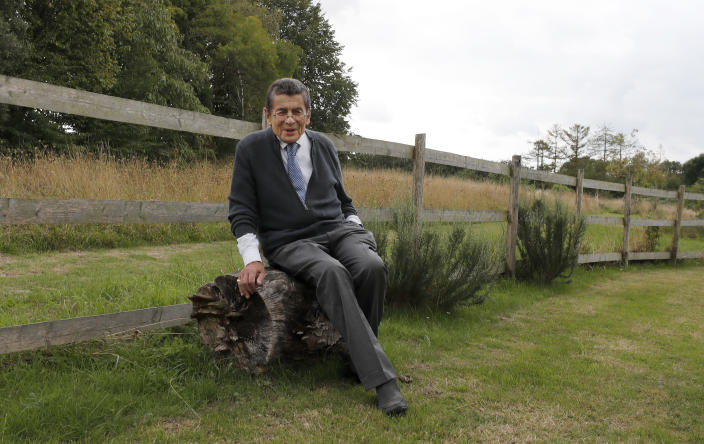 Human rights lawyer Geoffrey Nice takes a rest in his garden at his home in Adisham, England, Wednesday, Sept. 2, 2020. The prominent British human rights lawyer is convening an independent tribunal in London with public hearings next year, to look into the Chinese government's alleged rights abuses against the Uighur Muslim minority in the far western province of Xinjiang.(AP Photo/Frank Augstein)