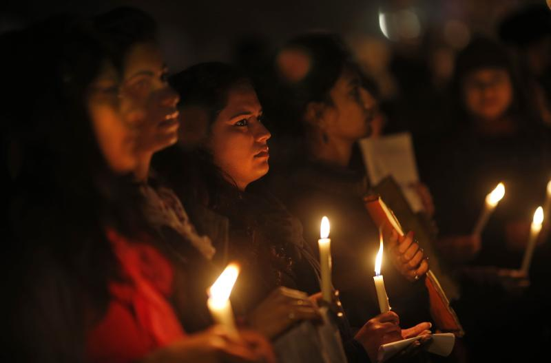 Indians hold a candle light vigil to salute the undying spirit of a rape victim and to mourn her death in New Delhi, India , Sunday, Dec. 30, 2012. The young woman who died after being gang-raped and beaten on a bus in India's capital was cremated Sunday amid an outpouring of anger and grief by millions across the country demanding greater protection for women from sexual violence. (AP Photo/ Saurabh Das)
